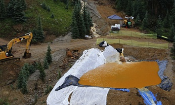 Water flows through one in a series of retention ponds built to contain and filter out heavy metals and chemicals from the Gold King mine wastewater accident, in the spillway downstream from the mine outside Silverton, Colo., on Aug. 12, 2015.