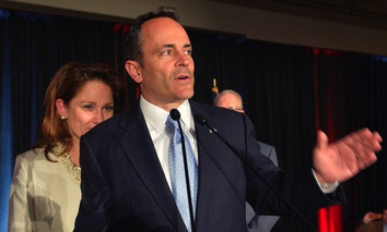 Glenna Bevin, left, wife of Kentucky Republican Governor-elect Matt Bevin looks over his shoulder as he gives his victory speech at the Republican Party victory celebration, Tuesday, Nov. 3, 2015.
