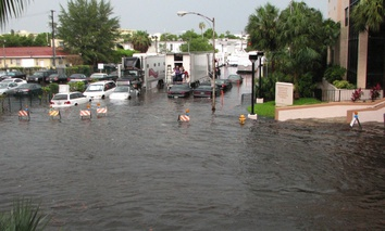Flooding in Miami Beach floods city streets.