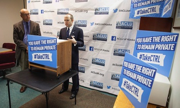State Rep. Andy Josephson, R-Anchorage, left, listens as Joshua Decker, executive director of the American Civil Liberties Union of Alaska, speaks about two bills on data privacy at a news conference in in Juneau, Alaska, Wednesday Jan. 20, 2016.
