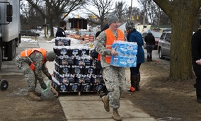 Bottled water distribution by the National Guard on Saturday at Fire Station 6 in downtown Flint, Michigan.