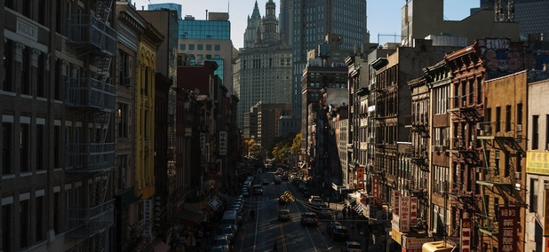 A street in Chinatown, looking toward the Manhattan Municipal Building.