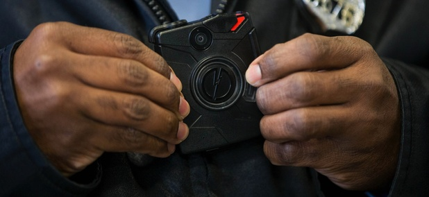 In this Dec. 11, 2014, file photo, a Philadelphia Police officer demonstrates a body-worn camera being used as part of a Philadelphia Police pilot project in the department's 22nd District