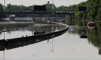 Cars remain stranded along a flooded section of Interstate 45 after heavy rains overnight in Houston, Tuesday, May 26, 2015.