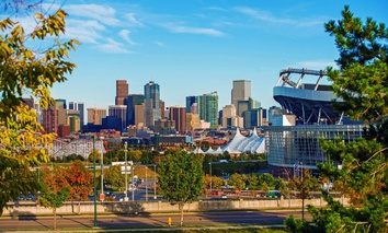 Denver, Colorado's cityscape with Mile High Stadium on the right.