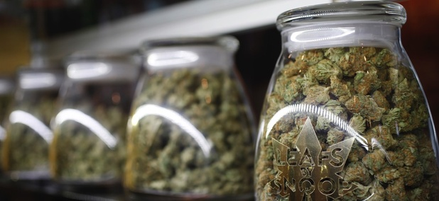 Jars of marijuana buds marketed by rapper Snoop Dogg in one of the LivWell marijuana chain's outlets south of downtown Denver.
