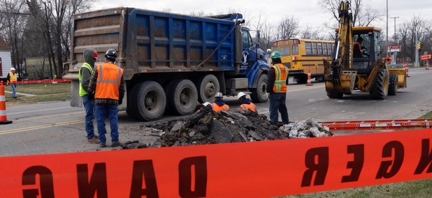 Crews replace lead service lines in Flint, Michigan.