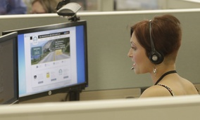 Gina Macaluso, an employee of Covered California, the state's health insurance exchange, provides information at a call center. California, Kentucky and Vermont had