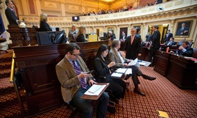 Virginia Sen. Majority Leader Thomas Norment, a Republican, looks over the media section.