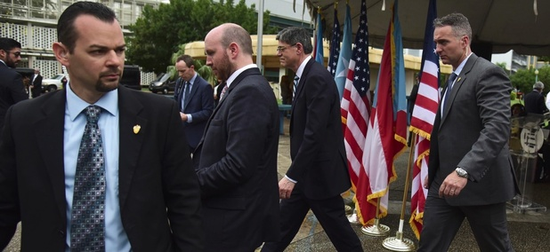 U.S. Treasury Secretary Jacob Lew is escorted by Secret Service agents after a press conference at the Central Medical Center in San Juan, Puerto Rico on May 9.
