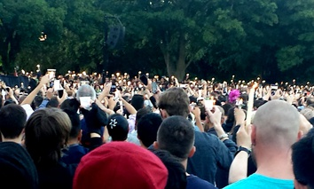 Thousands gathered in Seattle's Cal Anderson Park on Sunday for a candlelight vigil.