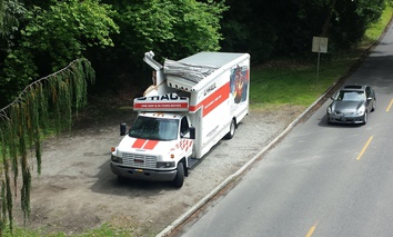 This U-Haul truck could not pass through the 9-foot clearance of this bridge in Seattle.
