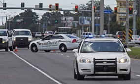 Baton Rouge Police arrive at the scene on Airline Highway after police were shot in Baton Rouge, La., Sunday, July 17, 2016.