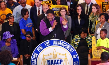 North Carolina NAACP president, Rev. William Barber, gesturing during a news conference in Richmond, Va. following the ruling.