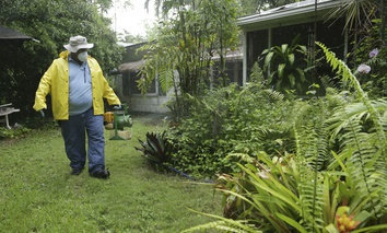 Robert Muxo, of the Miami-Dade County Mosquito Control department, sprays for mosquitoes, Tuesday, June 21, 2016, in Miami.
