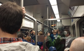 Aboard a crowded Sound Transit Link light-rail train in Seattle.