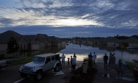 esidents line up on Providence Boulevard in Hammond, La., where flood waters inundated their homes after heavy rains in the region Saturday, Aug. 13, 2016.