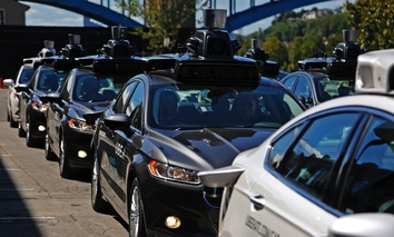 A fleet of Uber's autonomous vehicles in Pittsburgh.