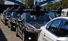 A fleet of Uber's autonomous vehicles in Pittsburgh.
