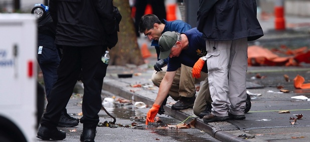 Evidence teams investigate the scene of Saturday's explosion in Manhattan's Chelsea neighborhood.