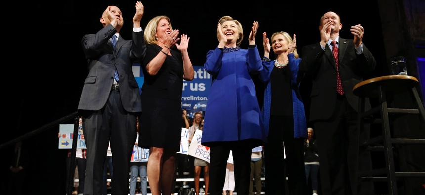 Democratic presidential candidate Hillary Clinton; Delaware Gov. Jack Markell, left; his wife, Carla; Sen. Chris Coons, right; and his wife, Annie, stand together at a campaign stop in Wilmington on April 25.