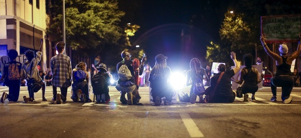 Black Lives Matter protesters sit on Peachtree Street during a protest in downtown Atlanta on Saturday.