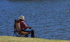 An older man fishes in Payson, Arizona. Some older American are leaving Sun Belt states like Arizona in favor of the colder states they moved from.