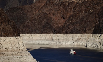 A riverboat glides through drought-stricken Lake Mead on the Colorado River at Hoover Dam near Boulder City, Nev.
