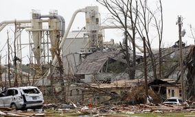 In a Tuesday, April 29, 2014 file photo, a wood products plant and its surrounding properties show the heavy damage from Monday's tornado in south Louisville, Miss.