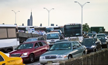 Cars and buses wait to enter the Lincoln Tunnel in Weehawken, New Jersey