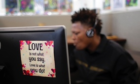 An advocate works in a cubicles at the National Domestic Violence Hotline center's new facility in Austin, Texas.