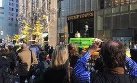Tourists and pedestrians in front of heightened security at the entrance to Trump Tower in New York City.