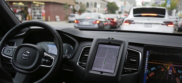 an Uber driverless car waits in traffic during a test drive in San Francisco.