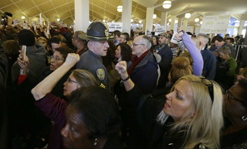 Demonstrators crowd the rotunda outside the House and Senate galleries during a special session at the North Carolina Legislature in Raleigh, N.C., Thursday, Dec. 15, 2016.