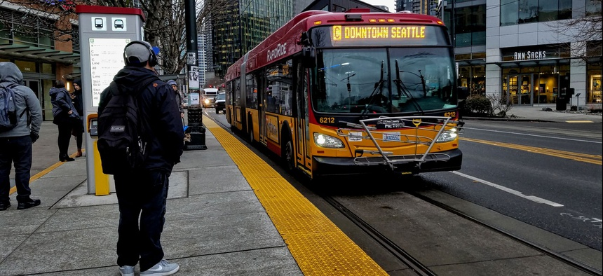 A hybrid-electric RapidRide bus, travels along Westlake Avenue in Seattle.