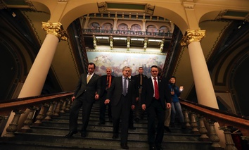 Iowa Gov. Terry Branstad, center, is escorted back to his office after delivering his annual condition of the state address before a joint session of the Iowa Legislature on Tuesday.