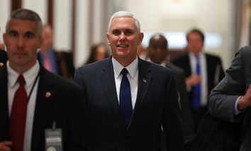 Vice President-elect Mike Pence walks through the halls of the Russell Senate Office Building on Capitol Hill in Washington D.C. on Tuesday.
