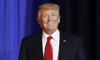 President Donald Trump smiles as he introduced before speaking at the Homeland Security Department in Washington, Wednesday, Jan. 25, 2017.