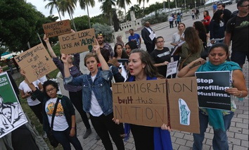 Protesters chant slogans against President Donald Trump's executive order on Muslim immigration Thursday in downtown Miami.