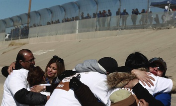 "Families and friends from both sides of the U.S.-Mexico border embrace during the ""Hugs not Walls"" event on the Rio Grande, in Ciudad Juarez, Mexico, on Saturday."