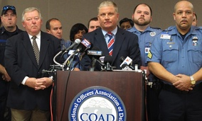 Geoffrey Klopp, center, president of the Correctional Officers Association of Delaware, speaks about a prison uprising Thursday in Dover.