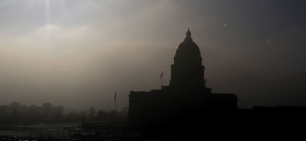 The Utah State Capitol is silhouetted against the smog-covered sky Wednesday, Feb. 6, 2013, in Salt Lake City.