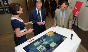 From right, Mayor Rusty Bailey of Riverside, Calif., Mayor John Giles of Mesa, Ariz., and Cathe Reams of Siemens.