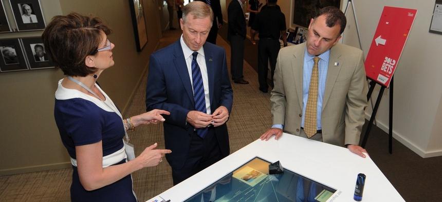 From right, Mayor Rusty Bailey of Riverside, Calif., Mayor John Giles of Mesa, Ariz., and Cathe Reams of Siemens.