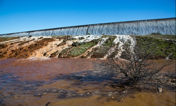 Water flows over the auxiliary spillway at the Oroville Dam in Northern California on Saturday.