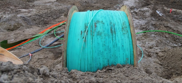Fiber-optic cable being laid.