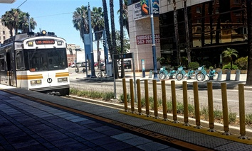 A Metro Blue Line train approaches the First Street Station in downtown Long Beach.
