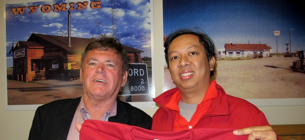 "Vietnamese businessman Nguyen Dinh Pham, right, poses with Don Sammons, the self-proclaimed ""mayor"" of Buford, Wyoming, after winning the auction for the town in 2012."