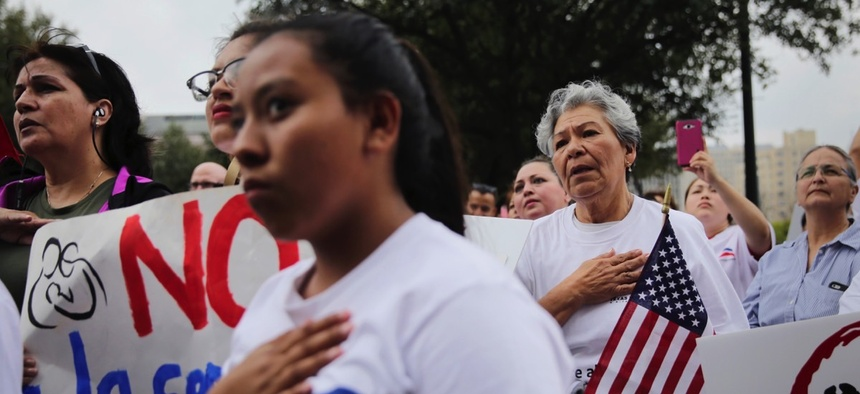 Protesters take part in a No Ban, No Wall immigrant rights rally to oppose a border wall and support sanctuary cities on Feb. 28 outside the State Capitol in Austin, Texas.