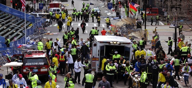Medical workers aid injured people following the explosion at the finish line of the 2013 Boston Marathon.
